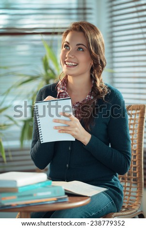 Girl making notes - stock photo