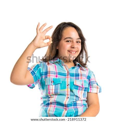 Girl making Ok sign over white background  - stock photo
