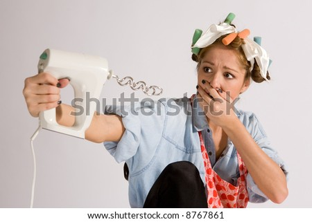 Girl making paste with hair curlers. - stock photo
