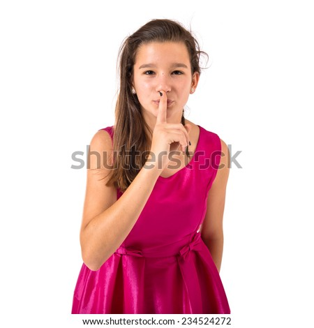Girl making silence gesture over isolated white background - stock photo
