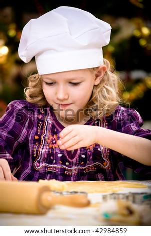 girl making xmas cookies at home