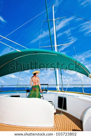 girl manages yacht - stock photo