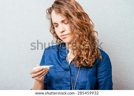 girl measures the temperature - stock photo