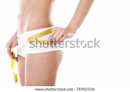 Girl measuring on a white background - stock photo