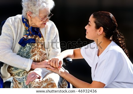 girl medical helping an old woman - stock photo