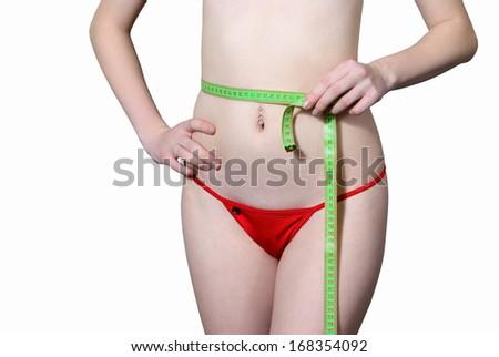 Girl meriet their waist size - stock photo