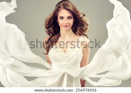 Girl model in a white wedding dress with elegant hairstyle - stock photo