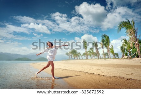 Girl model is located on the beautiful tropical coast. Rest, relaxation, travel. - stock photo