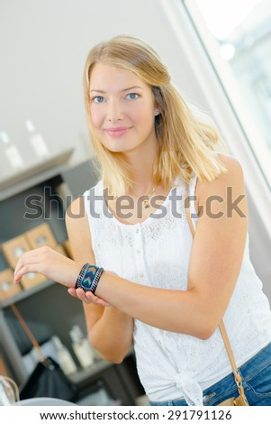 Girl modeling bracelet - stock photo