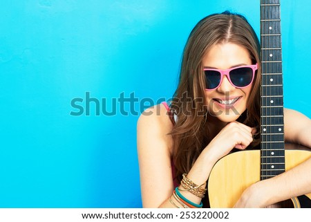 girl musician sitting on a floor with acoustic guitar . - stock photo