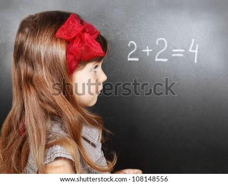 Girl Near Blackboard Learning Maths Side Portrait - stock photo