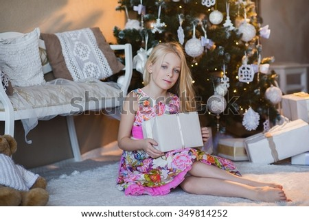 Girl near Christmas tree with presents and toys, boxes, Christmas, New Year, lifestyle, holiday, vacation, waiting for santa