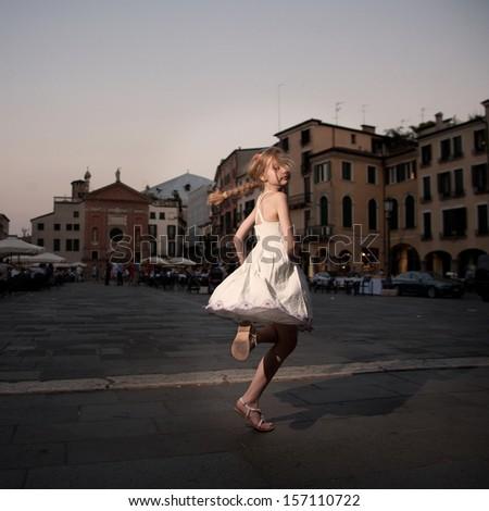 Girl near renesance villa - stock photo