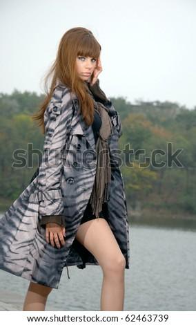 Girl near the river - stock photo