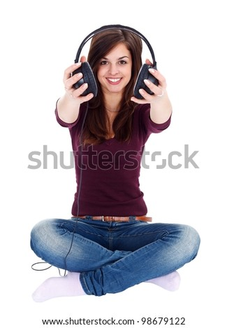 Girl offering us headphones while sitting on the floor