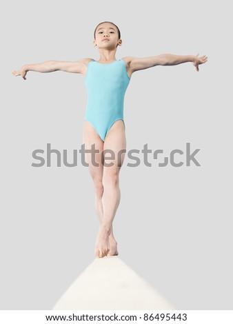 Girl on a balance beam - IE050-079 - stock photo
