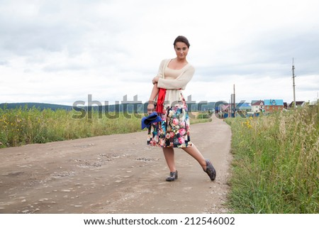 girl on a country road