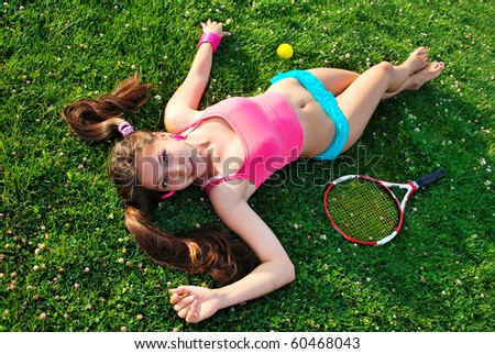 girl on a grass with racket - stock photo