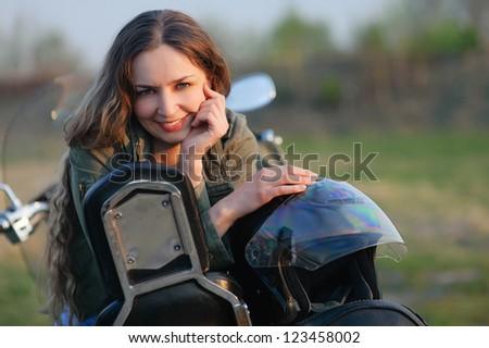 girl on a motorbike - stock photo