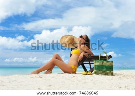 Girl on a tropical beach - stock photo