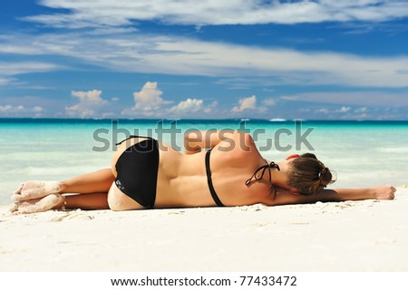 Girl on a tropical beach - stock photo
