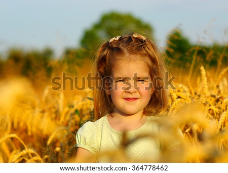 Girl on a wheat field - stock photo