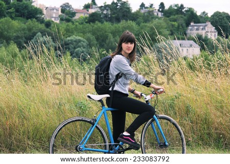 girl on bicycle nature - stock photo