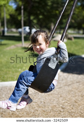 Girl on Cable Swing at a Park - stock photo