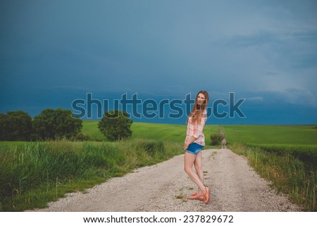 girl on field road