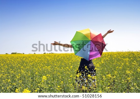girl on fileld with umbrella - stock photo