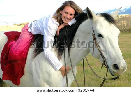 Girl on horse - stock photo