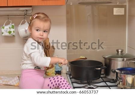 girl on kitchen - stock photo