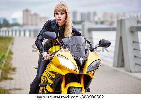Girl on motorcycle - stock photo