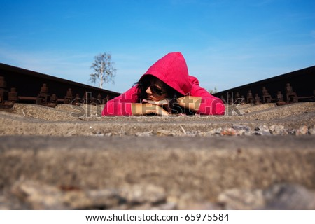 girl on railway track - stock photo