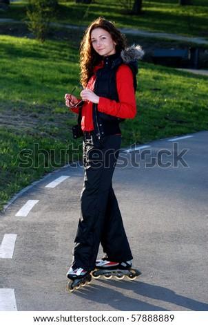 Girl on roller skates. - stock photo