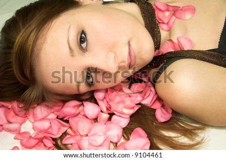 girl on rose bed - stock photo