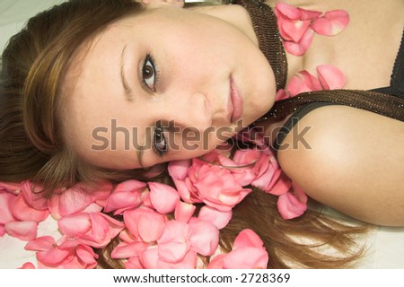 girl on roses - stock photo