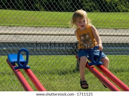 girl on seesaw - stock photo