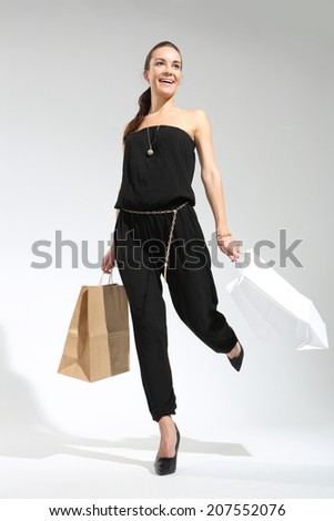 Girl on shopping . Young, attractive girl in a summer dress with a large bag purchasing  - stock photo