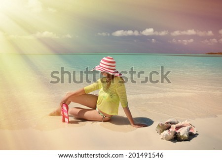 Girl on the beach of Exuma, Bahamas  - stock photo