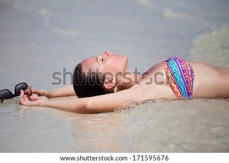 Girl on the beach on a sunny day - stock photo