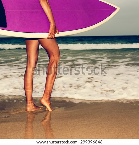 Girl on the Beach with bright Surf board. Surfing Time - stock photo