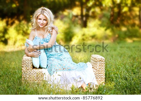girl on the couch with rattan garden