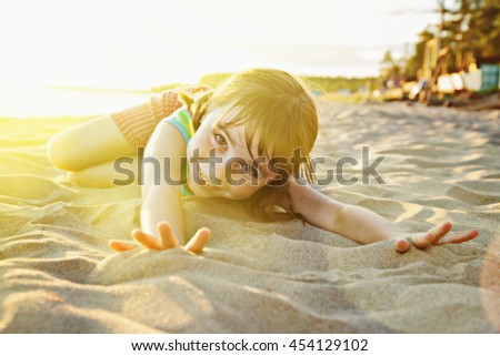 Girl on the nature of the sunset. - stock photo