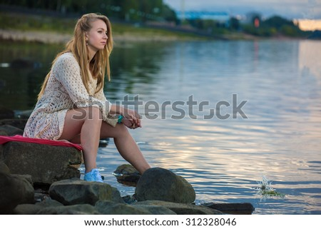 Girl on the river - stock photo