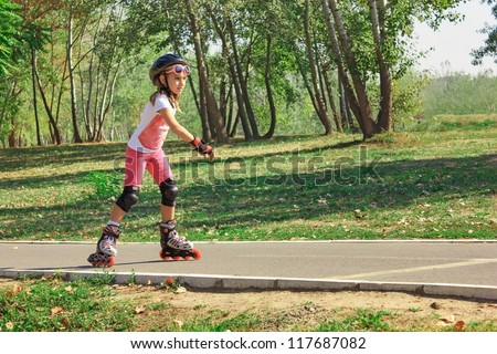 Girl on the rollerblades - stock photo
