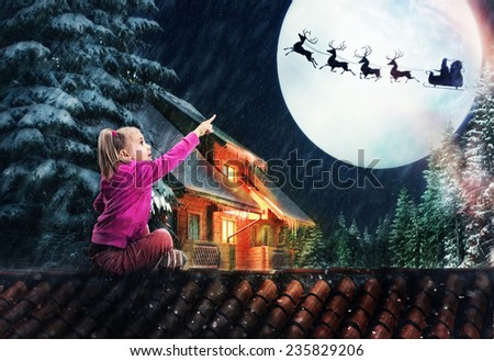Girl on the roof in The Christmas eve - stock photo