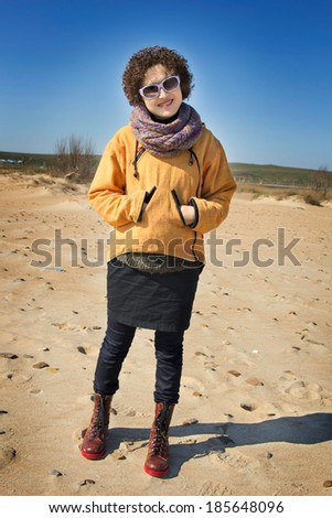 girl on the seashore. Early spring - stock photo