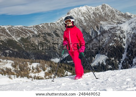 Girl on the ski slope - stock photo