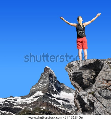 Girl on the top, in the background mountain Matterhorn - Swiss Alps, Europe  - stock photo